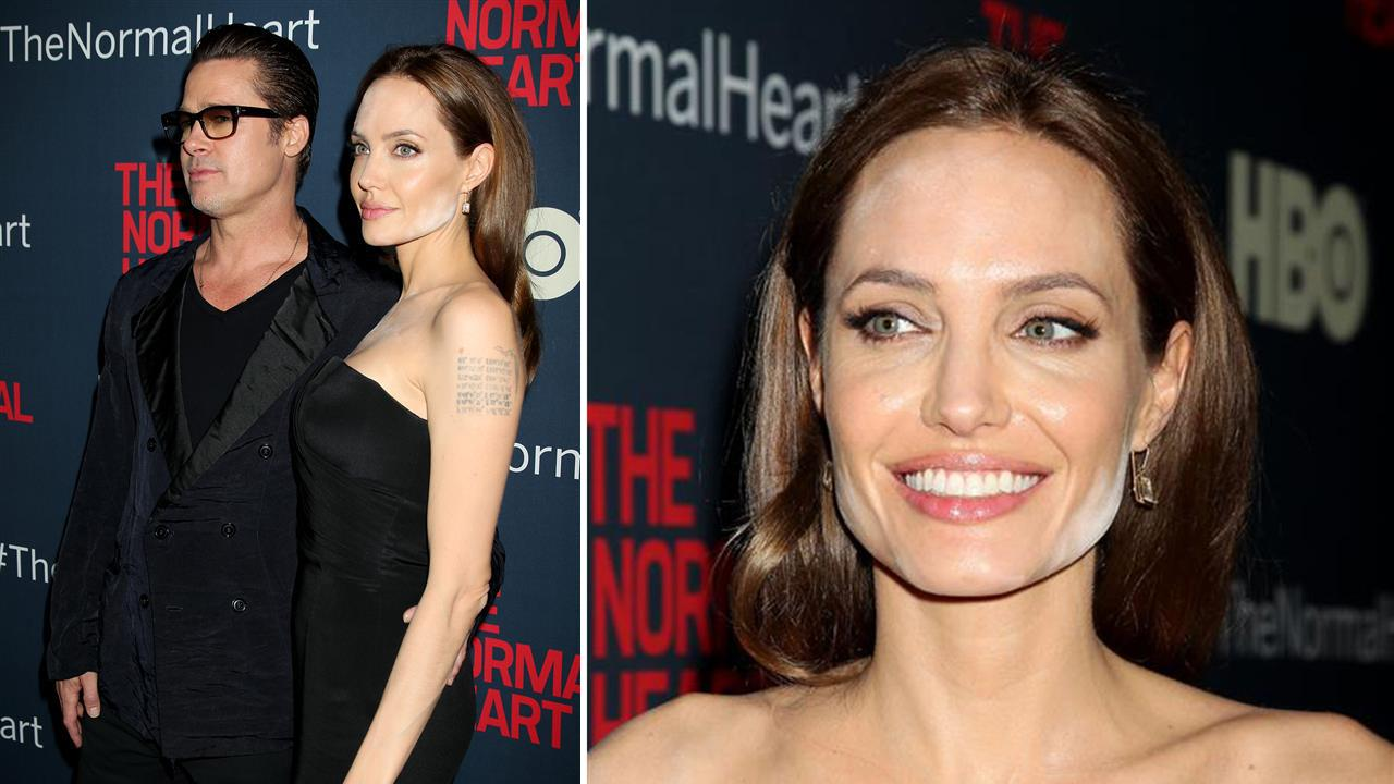 Angelina Jolie and Brad Pitt appear at the premiere of the HBO film A Normal Heart in New York on May 12, 2014.