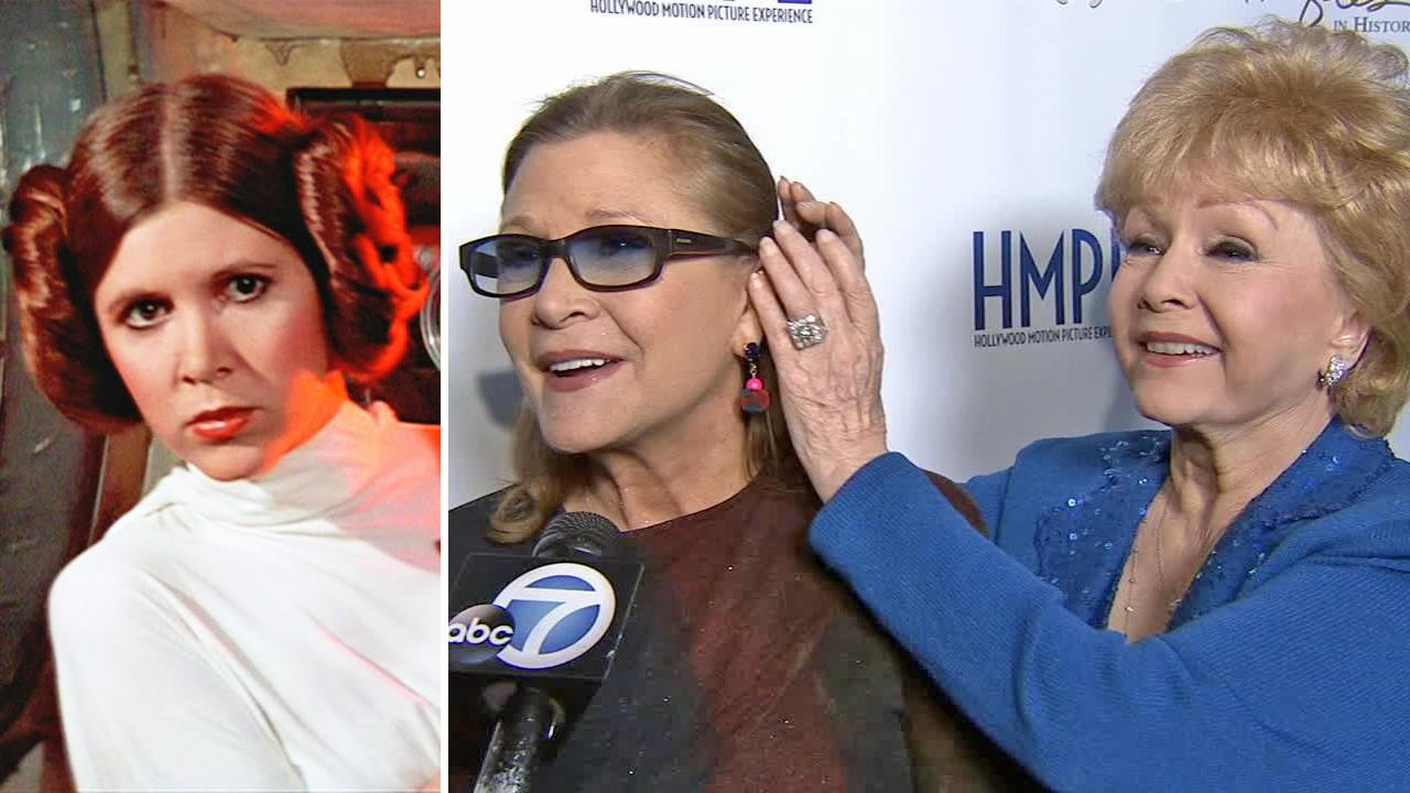 Carrie Fisher appears as Star Wars Princess Leia. / Carrie Fisher and her mother, actress Debbie Reynolds, talk to OTRC.com at the elder stars movie memorabilia auction event near Los Angeles on May 14, 2014.