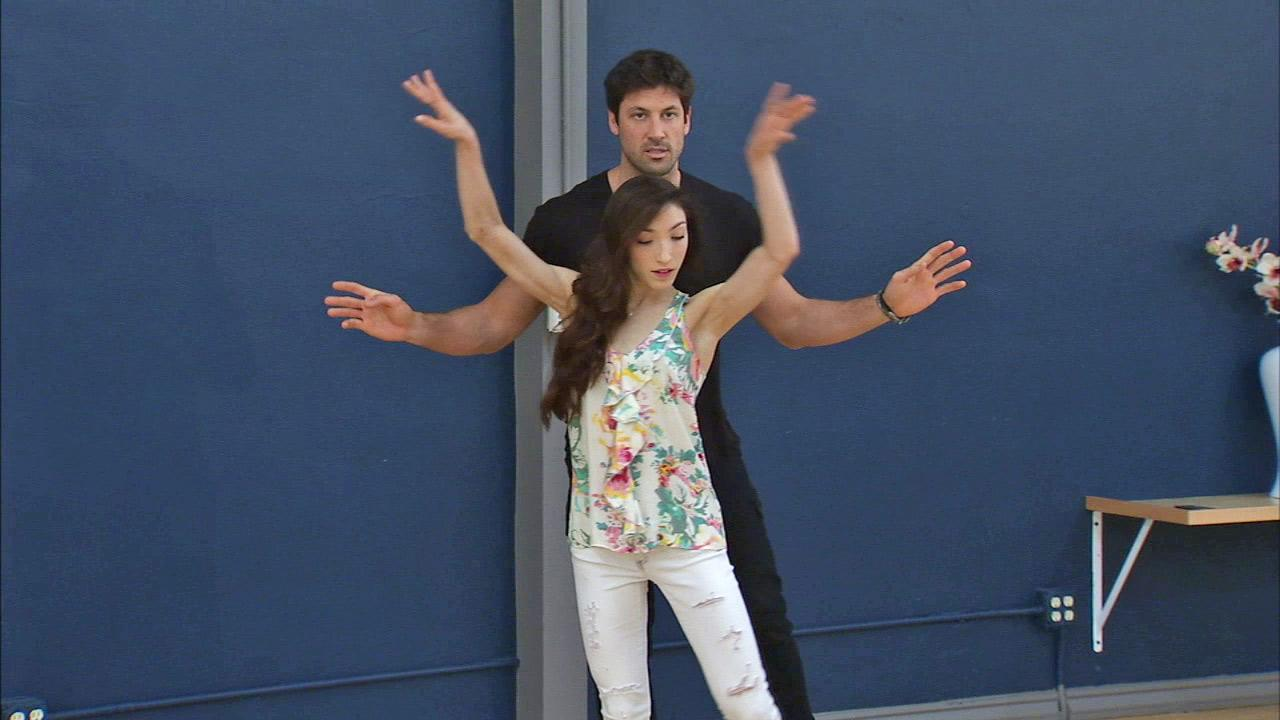 Meryl Davis and Maksim Chmerkovskiy rehearse for the Dancing With The Stars season 18 finale on May 15, 2014.