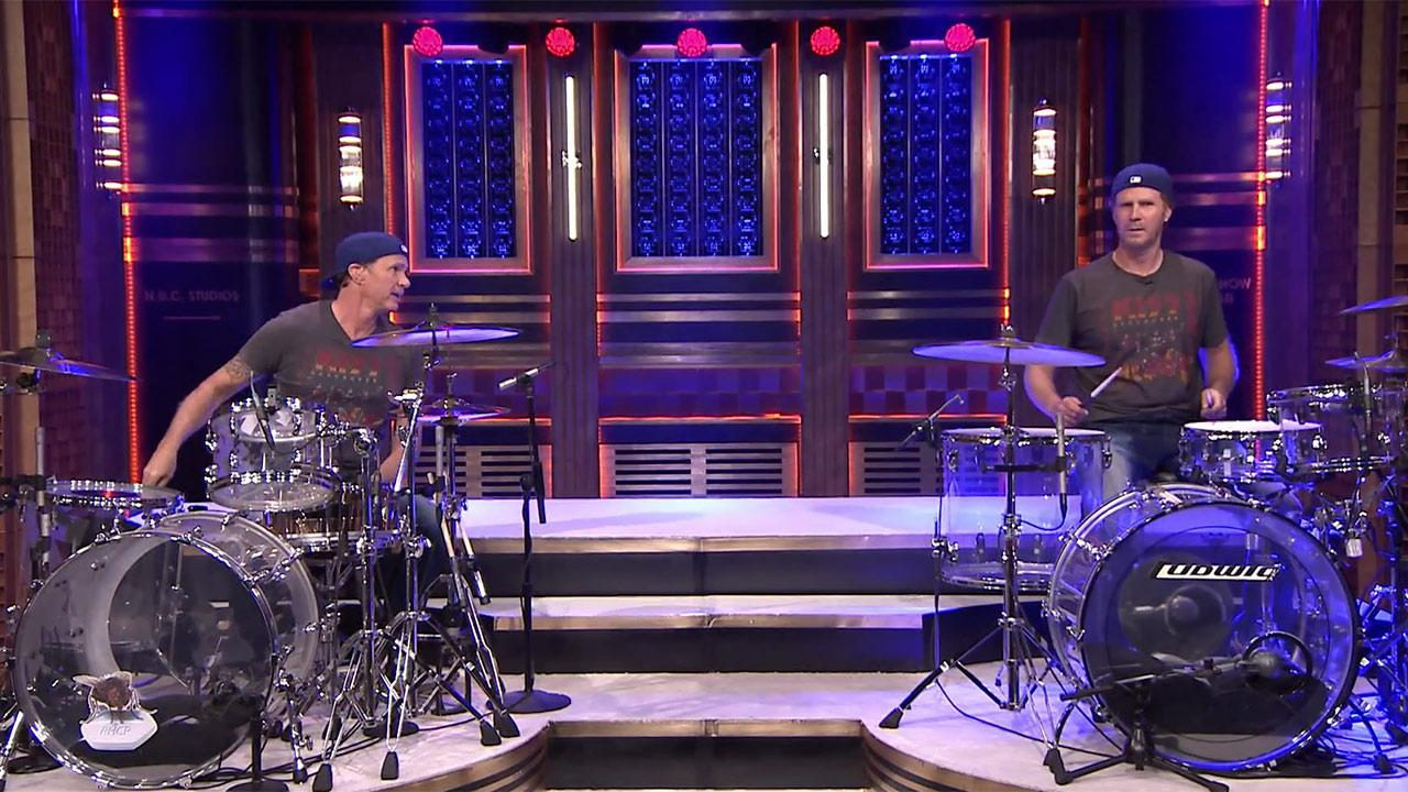 Chad Smith of the Red Hot Chili Peppers and Will Ferrell take part in a drum-off on The Tonight Show starring Jimmy Fallon in an episode that aired on May 22, 2014.