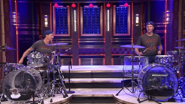 Chad Smith of the Red Hot Chili Peppers and Will Ferrell take part in a drum-off on The Tonight Show starring Jimmy Fallon in an episode that aired on May 22, 2014. - Provided courtesy of NBC
