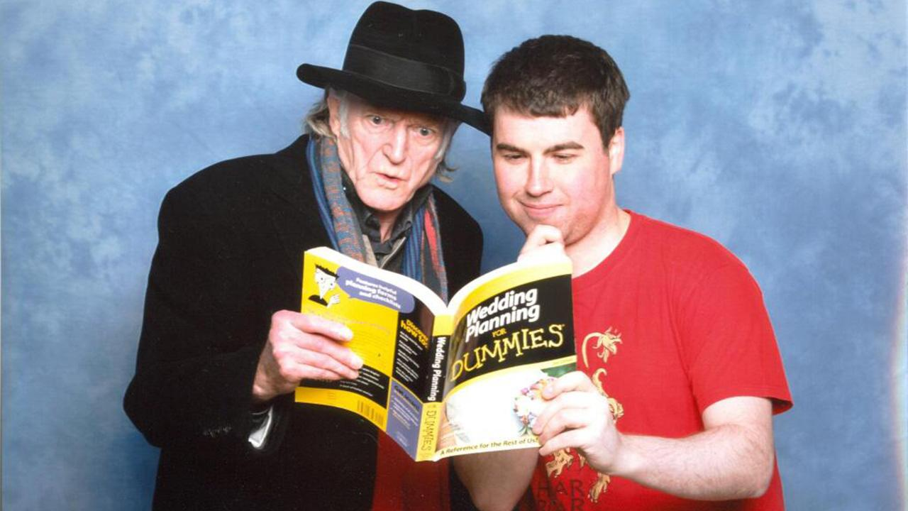 British Game of Thrones fan Gareth Shaw posted this photo on Twitter on May 29, 2014. It is a perfectly-staged photo of himself and star David Bradley, who plays Walder Frey. The two pretend to be reading the book Wedding Planning For Dummies.