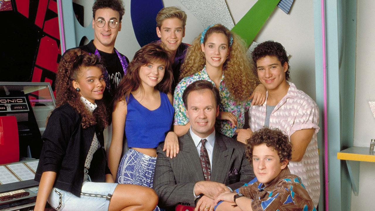 Elizabeth Berkley, Mark-Paul Gosselaar, Tiffani Thiessen, Ed Alonzo, Dustin Diamond, Dennis Haskins, Mario Lopez and Lark Voorhies appear in a 1989 promotional photo for Saved by the Bell.