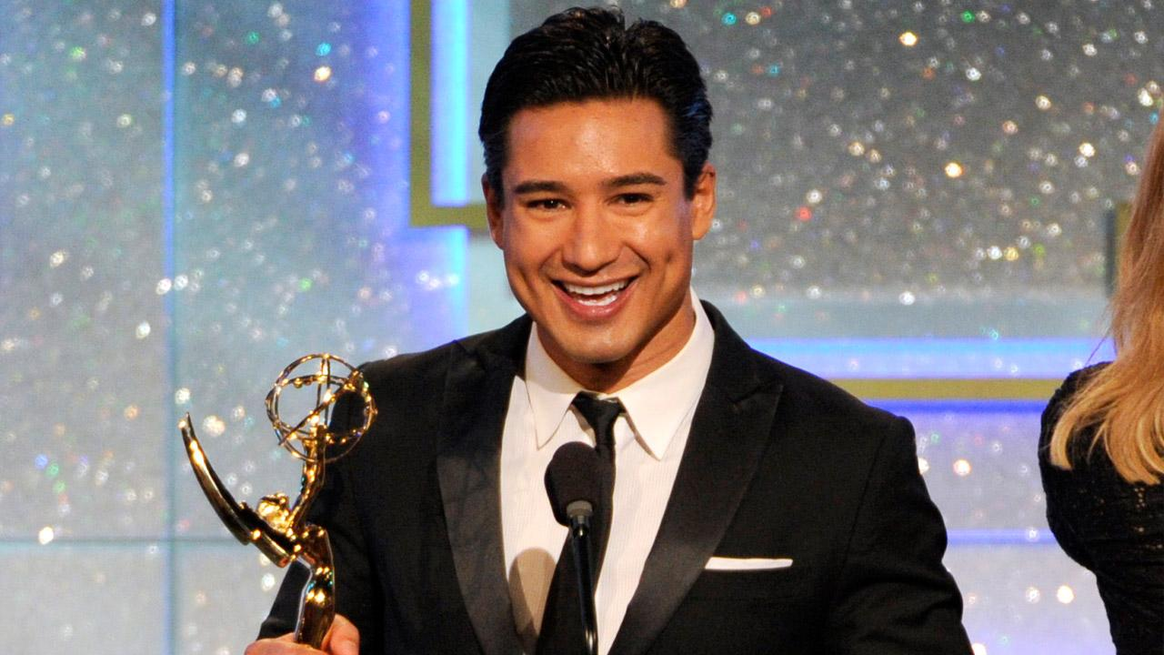 Mario Lopez accepts the award for outstanding entertainment news program for Extra at the 41st annual Daytime Emmy Awards at the Beverly Hilton Hotel on Sunday, June 22, 2014, in Beverly Hills, Calif.