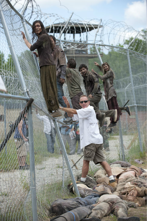 "<div class=""meta ""><span class=""caption-text "">Walkers and Stunt Coordinator Russell Towery appear on the set of AMC's 'The Walking Dead' while filming episode 2 of season 4, titled 'Infected,' which aired on Oct. 20, 2013.  (Gene Page / AMC)</span></div>"
