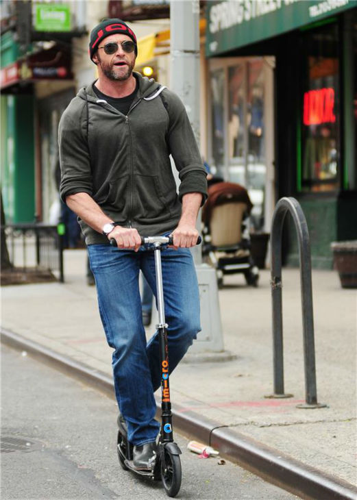 Hugh Jackman rides a scooter in New York City on April 22, 2013.  <span class=meta>(Humberto Carreno &#47; Startraksphoto.com)</span>
