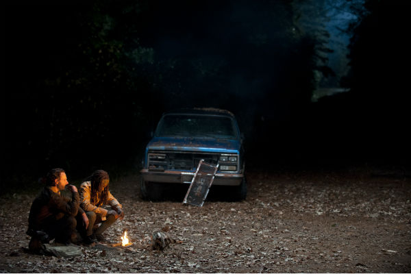 Rick Grimes &#40;Andrew Lincoln&#41; and Michonne &#40;Danai Gurira&#41; talk as Carl Grimes &#40;Chandler Riggs&#41; sleeps inside the vehicle near them, in this scene from AMC&#39;s &#39;The Walking Dead&#39; season 4 finale, which aired on March 30, 2014. <span class=meta>(Gene Page&#47;AMC)</span>
