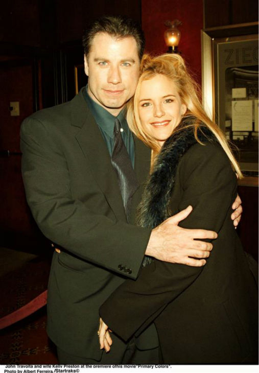 John Travolta and wife Kelly Preston appear at the premiere on the movie 'Primary Colors' in New York on Jan. 23, 1998.