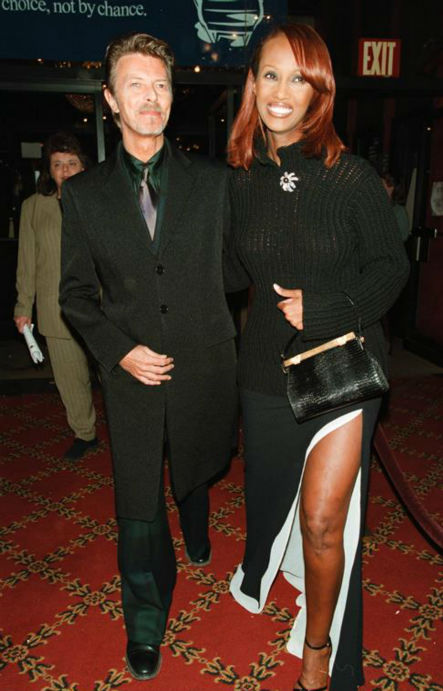 "<div class=""meta image-caption""><div class=""origin-logo origin-image ""><span></span></div><span class=""caption-text"">David Bowie and wife Iman appear at the premiere of 'Meet Joe Black' in New York on Nov. 2, 1998. The two married in 1992 and have a daughter. (Startraksphoto.com)</span></div>"
