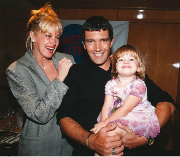 Antonio Banderas and wife Melanie Griffith appear with daughter Stella at a screening of 'The Mask of Zorro' at Planet Hollywood in New York on Dec. 18, 1998.