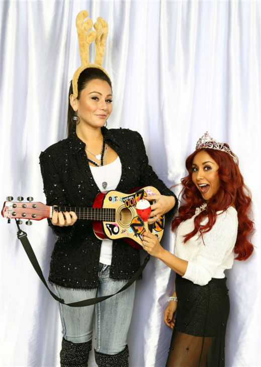 "<div class=""meta image-caption""><div class=""origin-logo origin-image ""><span></span></div><span class=""caption-text"">Reality stars JWoww and Snooki pose in a holiday-themed photo booth at Z100's Jingle Ball 2013 on Dec. 13, 2013, just before Christmas. (Sara Jaye Weiss  / Startraksphoto.com)</span></div>"