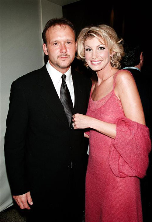 "<div class=""meta image-caption""><div class=""origin-logo origin-image ""><span></span></div><span class=""caption-text"">Faith Hill and husband and fellow country star Tim McGraw appear at the 18th annual American Fashion Awards in New York on Dec. 31, 1999. The two married in October 1996 and are parents to three daughters. (Startraksphoto.com)</span></div>"
