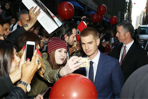 "<div class=""meta ""><span class=""caption-text "">Andrew Garfield poses with fans at the premiere of 'The Amazing Spider-Man 2' in New York on April 24, 2014. He plays Spider-Man / Peter Parker. He is wearing a blue and purple checked Alexander McQueen. (Marion Curtis / Startraksphoto.com)</span></div>"