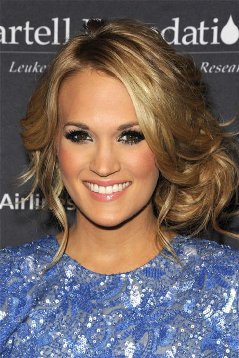 "<div class=""meta ""><span class=""caption-text "">Carrie Underwood appears at the T.J. Martell Foundation's 38th Annual Honors Gala in New York on Oct. 22, 2013. The country star, who wore a beaded, tulle periwinkle-colored Randi Rahm cocktail dress, was given the 2013 Artist Acheivement Award at the event. The T.J. Martell Foundation funds medical research aimed at finding cures for leukemia, cancer and AIDS.  (Bill Davila / Startraksphoto.com)</span></div>"