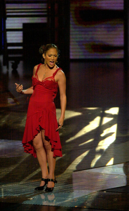 Jennifer Lopez performs in San Juan, Puerto Rico, on Sept. 22, 2001. Lopez went back to her roots for a concert in her parents&#39; homeland. <span class=meta>(AP Photo &#47; Tomas van Houtryve)</span>
