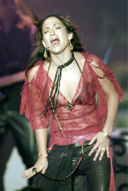 Jennifer Lopez performs on stage in Freiburg, southern Germany on Saturday, Nov. 24, 2001. Lopez was the main star on the television variety show &#39;Verstehen Sie Spass?&#39; <span class=meta>(AP Photo &#47; Winfried Rothermel)</span>