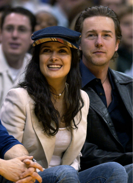 Salma Hayek, left, and her boyfriend, actor Edward Norton, watch the Los Angeles Lakers take on the Washington Wizards in Los Angeles on March 28, 2003. The Lakers won 108-94.