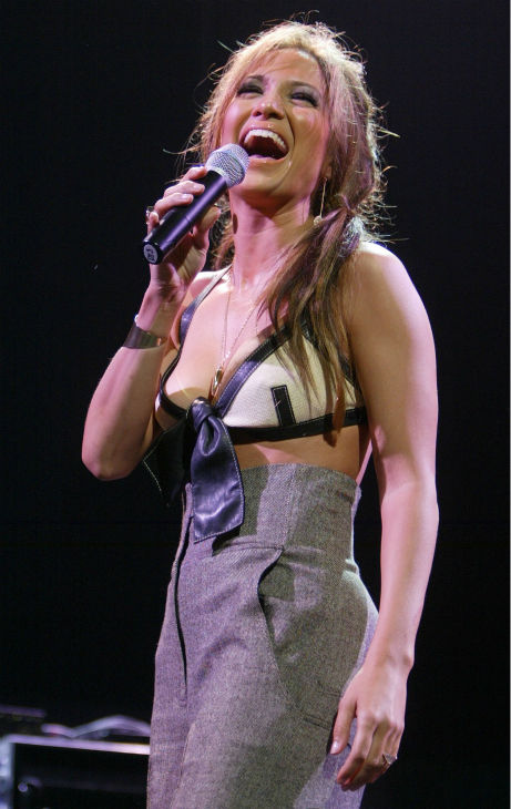 "<div class=""meta ""><span class=""caption-text "">Jennifer Lopez performs at KIIS-FM's Jingle Ball 2003 at Staples Center in Los Angeles in Los Angeles on Friday, Dec. 5, 2003. (AP Photo / Chris Carlson)</span></div>"