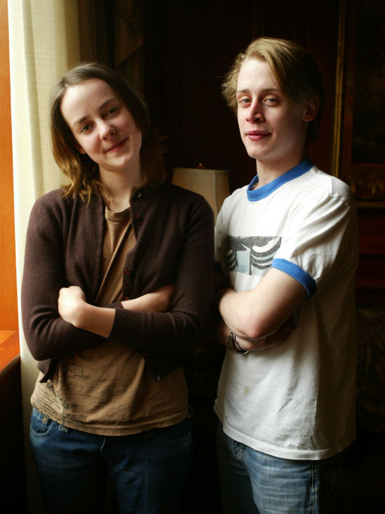 Macaulay Culkin, right, and Jena Malone, who star in the movie 'Saved!,' pose at the Ritz Carlton Hotel in Washington on May 5, 2004.