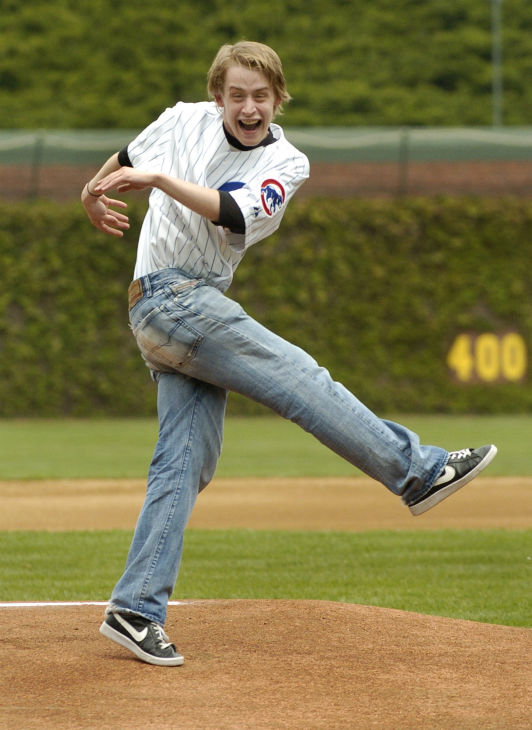 Macaulay Culkin reacts after throwing the ceremonial first pitch into the dirt before the Chicago Cubs' game against the Arizona Diamondbacks on Thursday, May 6, 2004, in Chicago.