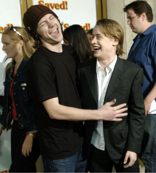 'Saved!' cast members Patrick Fugit, left, and Macaulay Culkin share a laugh at a screening of the film in the Westwood section of Los Angeles on Thursday, May 13, 2004.