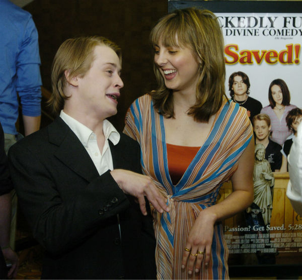 'Saved!' cast members Macaulay Culkin, left, and Eva Amurri mingle at the premiere of the film in the Westwood section of Los Angeles on Thursday, May 13, 2004.