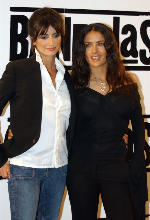 Penelope Cruz, left, and Salma Hayek poses for...