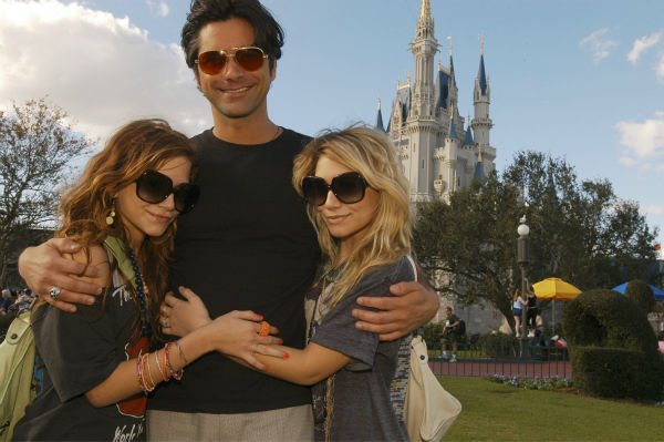 Mary-Kate, left, and Ashley Olsen are seen with former 'Full House' co-star John Stamos on Sunday, Jan. 2, 2005, at the Walt Disney World Resort in Lake Buena Vista, Florida.