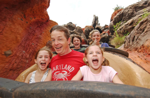 In this photo supplied by Walt Disney World, actor Michael J. Fox, center, enjoys Splash Mountain at the Magic Kingdom with his twin daughters Aquinnah Kathleen, 10, left, and Schuyler Frances, right, his son Sam, 15, background, and his wife, actress Tracy Pollan on Friday, March 25, 2005. <span class=meta>(Walt Disney World &#47; Diana Zalucky)</span>