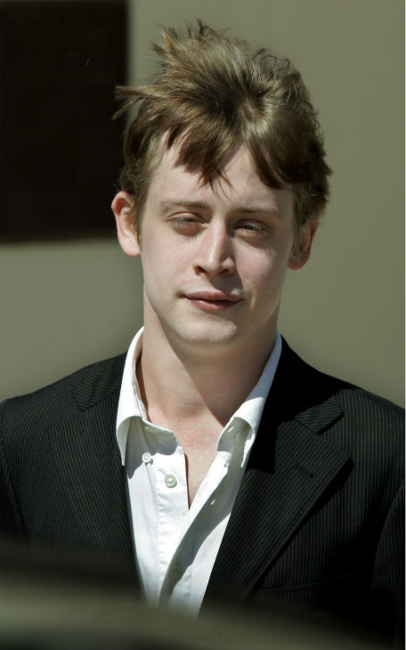 The wind musses actor Macaulay Culkin's hair as...