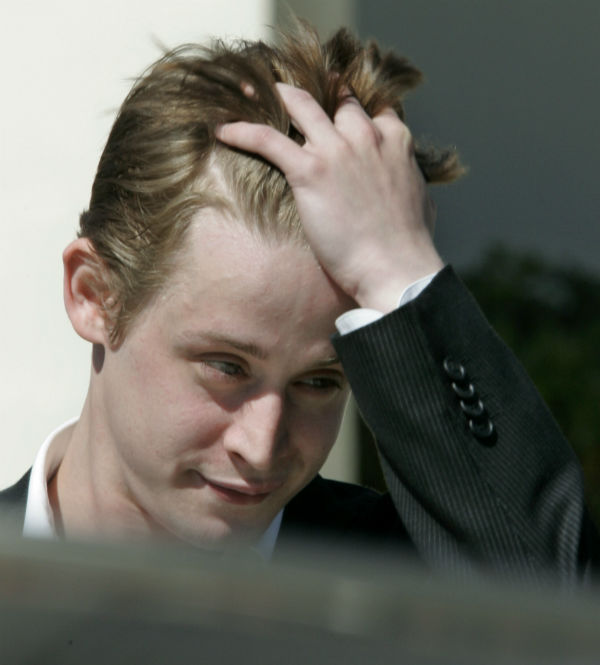 "<div class=""meta image-caption""><div class=""origin-logo origin-image ""><span></span></div><span class=""caption-text"">Macaulay Culkin puts his hand through his wind-blown hair as he leaves the courthouse after testifying as a witness for the defense in the Michael Jackson child molestation trial at the courthouse in Santa Maria, California on Wednesday, May 11, 2005.  (AP Photo / Reed Saxon)</span></div>"