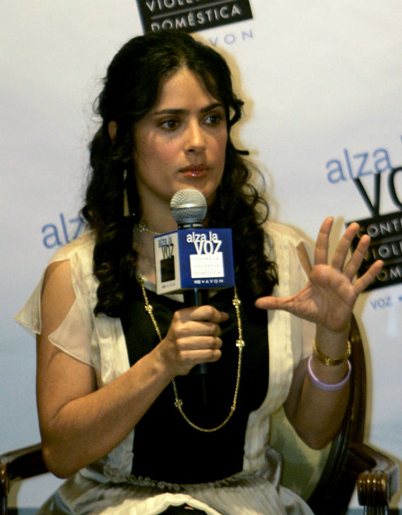 Salma Hayek speaks during a news conference about domestic violence in Mexico City on Feb. 14, 2006.  Calling domestic violence a problem that touches every corner of the globe, The Mexican actress gave a $25,000 donation to a battered woman's shelter in