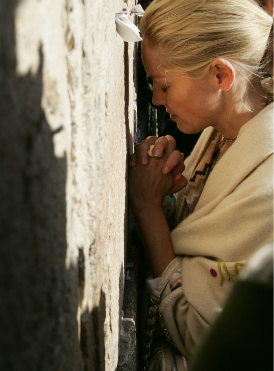 Sharon Stone prays at the Western Wall during a visit to Jerusalem&#39;s Old City on March 12, 2006. <span class=meta>(AP Photo &#47; Oded Bality)</span>