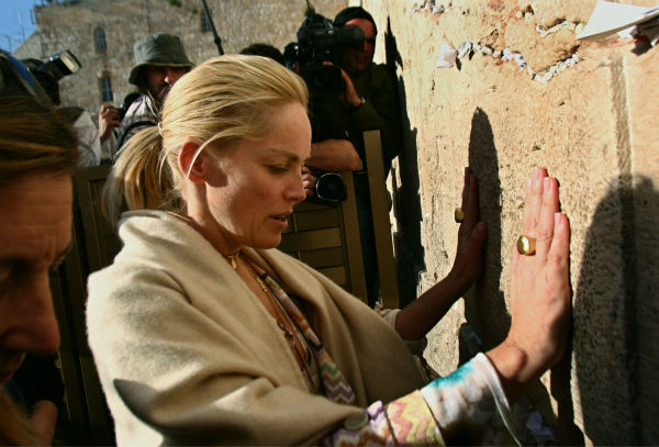 Sharon Stone prays at the Western Wall during a visit to Jerusalem&#39;s Old City on March 12, 2006. <span class=meta>(AP Photo &#47; Limor Edrey)</span>