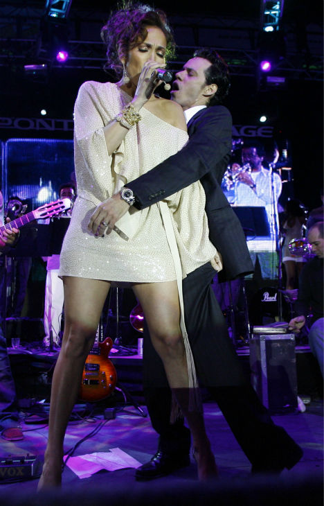 Jennifer Lopez performs with husband Marc Anthony during the Ocean Drive&#47;Market America Super Bowl XLI party in the South Beach section of Miami Beach, Florida on Saturday night, Feb. 3, 2007. <span class=meta>(AP Photo &#47; Chris Polk)</span>