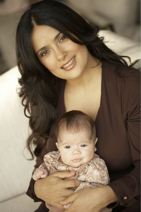 Salma Hayek poses with her new daughter Valentina Pinault, whose father is then-fiance Francois-Henri Pinault, on Nov. 20, 2007.