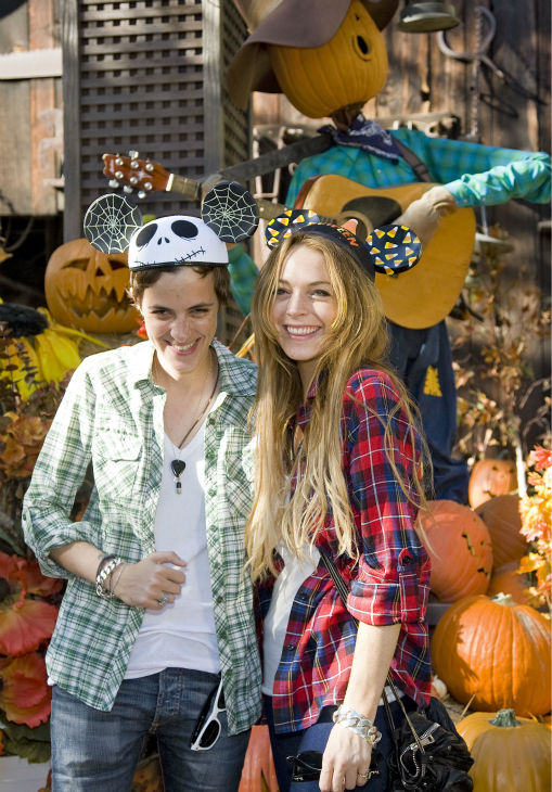 In this image released by Disneyland, actress Lindsay Lohan, right, and Samantha Ronson pose together at a preview of Disney's 'HalloweenTime