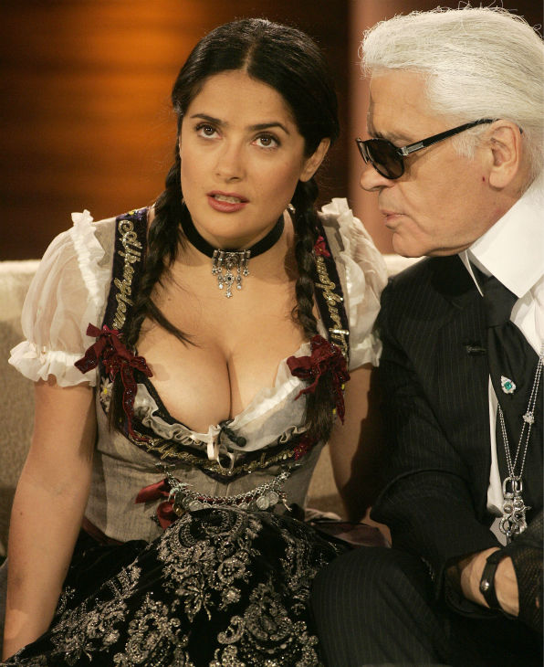 Salma Hayek wears a traditional Bavarian Drindl dress as she chats with German fashion designer Karl Lagerfeld during the German television show &#39;Wetten dass...?&#39;in Nuremberg, Germany on Oct. 4, 2008. <span class=meta>(AP Photo &#47; Alexandra Beier)</span>