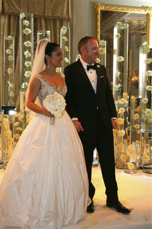 Salma Hayek and French businessman Francois-Henri Pinault are shown at their wedding in Venice, Italy on April 25, 2009.  The two had wed previously in a civil ceremony at the 6th Arrondisement City Hall in Paris on Feb. 14, 2009 - Valentine&#39;s Day.  In this photo, Hayek is wearing a Balenciaga wedding gown by Nicolas Ghesquiere. <span class=meta>(ID Public Relations &#47; AP Photo&#47; Bertrand Rindoff-Petroff)</span>