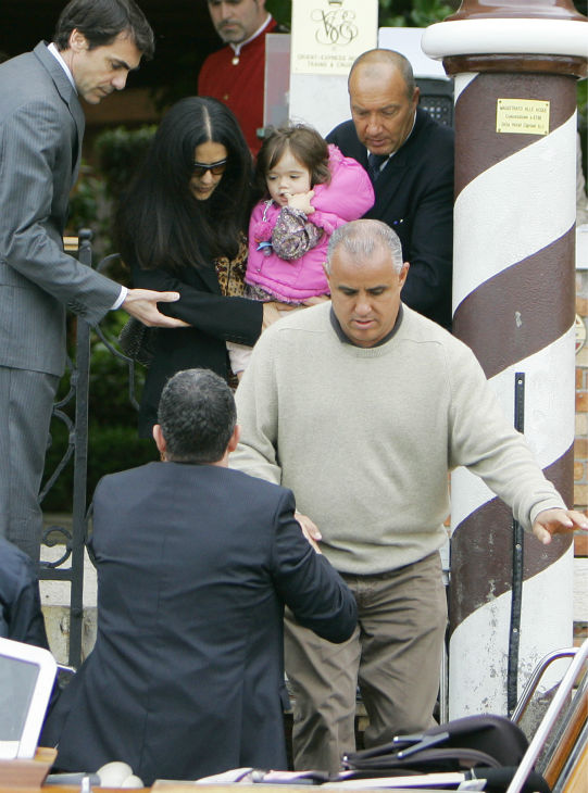 Salma Hayek, center, carries her daughter Valentina Paloma, as she leaves a hotel, in Venice, Italy on April 26, 2009.