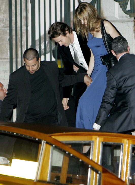 Edward Norton, center, leaves 'La Fenice theater after the wedding ceremony of ex-girlfriend Salma Hayek and Francois-Henri Pinault in Venice, Italy on April 26, 2009.