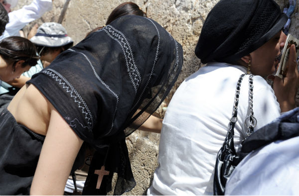 Lady Gaga, covered with a black scarf, prays at the Western Wall in Jerusalem&#39;s Old City on Aug. 18, 2009, a day before she performed in Tel Aviv. <span class=meta>(AP Photo &#47; Laura Weisman)</span>