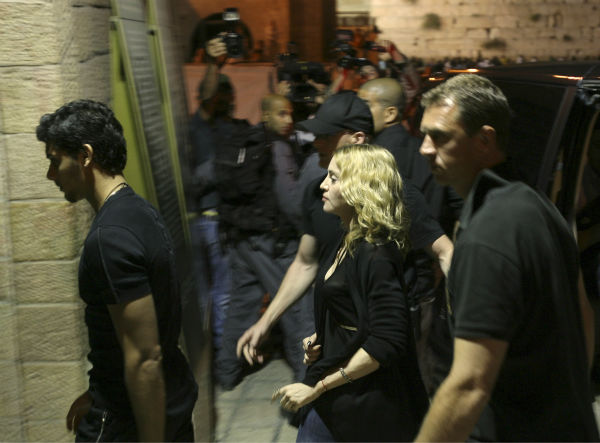 Madonna walks through the tunnels of the Western Wall at nightfall on Aug. 30, 2009, ahead of two concerts in Tel Aviv. <span class=meta>(AP Photo &#47; Haim Zach)</span>