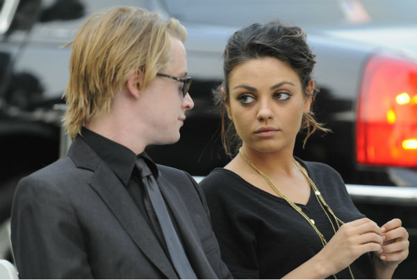 In this handout photo provided by Harrison Funk and the Jackson Family, Macaulay Culkin and then-girlfriend Mila Kunis attend Michael Jackson's funeral service held at Glendale Forest Lawn Memorial Park on Sept. 3, 2009 in Glendale, California. Jackson, 5
