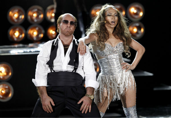 "<div class=""meta ""><span class=""caption-text "">Tom Cruise, dressed as his character from 'Tropic Thunder,' and Jennifer Lopez perform at the MTV Movie Awards in Universal City, California on Sunday, June 6, 2010. (AP Photo / Matt Sayles)</span></div>"