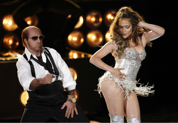 Tom Cruise, dressed as his character from 'Tropic Thunder,' and Jennifer Lopez perform at the MTV Movie Awards in Universal City, California on Sunday, June 6, 2010.