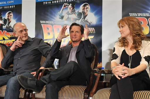 In this photograph taken by AP Images for Universal Studios Home Entertainment - Christopher Lloyd, left, Michael J. Fox, center, and Lea Thompson at the Back to the Future 25th Anniversary Trilogy Blu-ray and DVD press conference, Monday, Oct. 25, 2010,