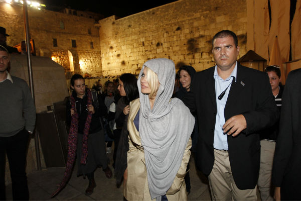 Pamela Anderson visits the Western Wall in Jerusalem&#39;s Old City on Nov. 7, 2010. <span class=meta>(AP Photo &#47; Tara Todras-Whitehill)</span>