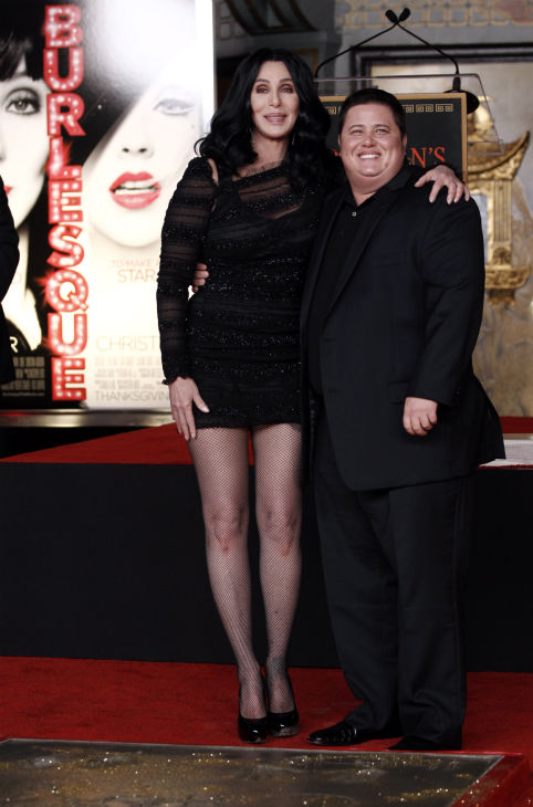 Cher, left, and Chaz Bono pose together after a...