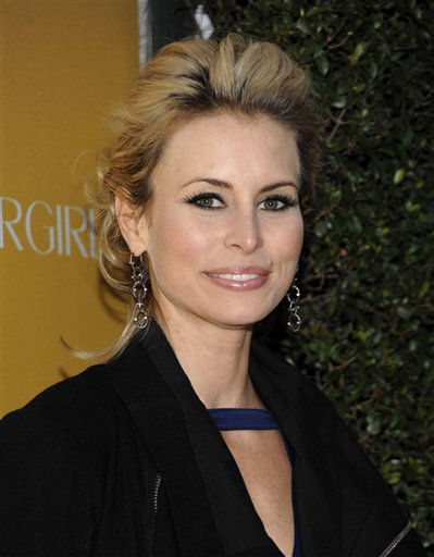 Model Niki Taylor is one of the 2011 contestants of Donald Trump's reality show 'Celebrity Apprentice. (Pictured: Niki Taylor arrives at the COVERGIRL Cosmetics' 50th Anniversary Party in Los Angeles on Wednesday, Jan. 5, 2011.)
